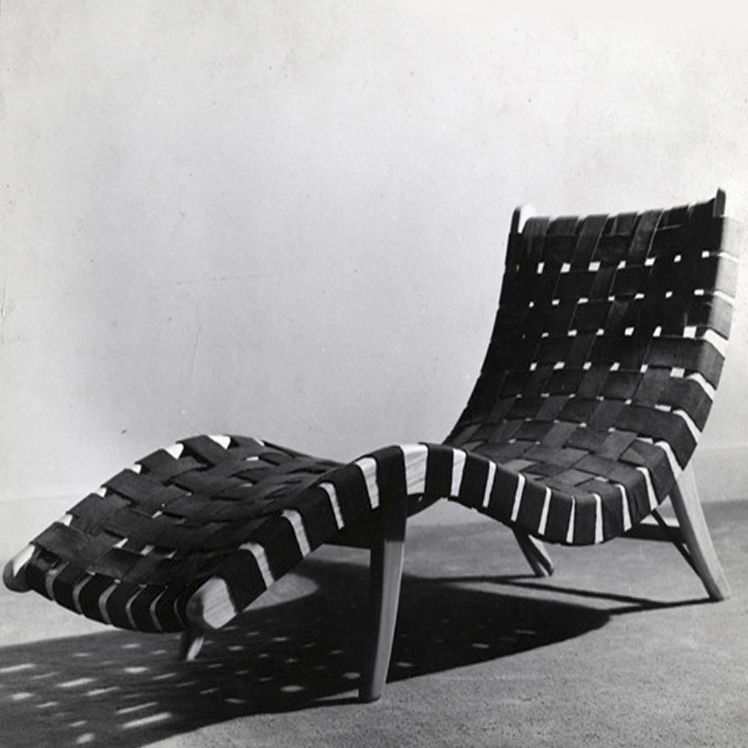 Woven lounge chair. Mixture of primavera wood and cotton material. Four wooden minimalist legs.