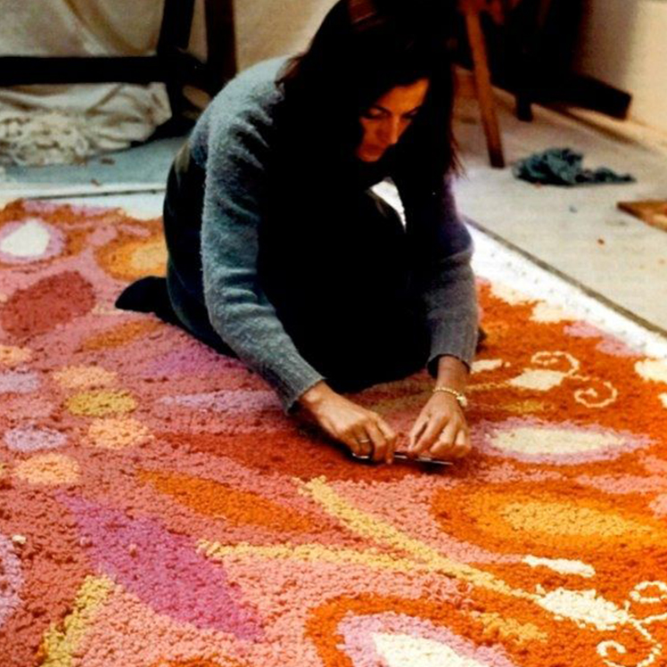 Cynthia Sargent photographed in New Mexico in the 1970s weaving one of her rugs