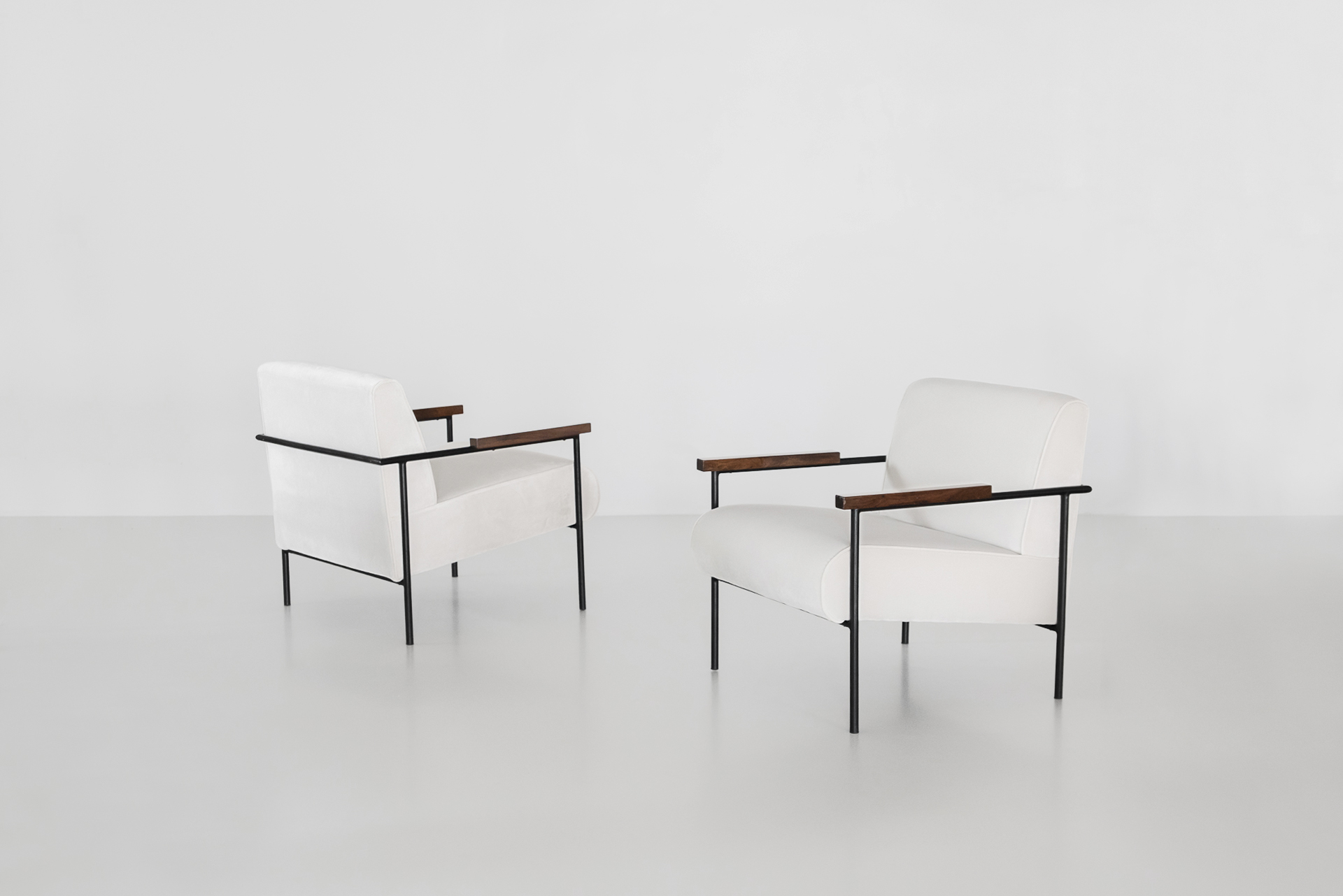Geraldo de barros armchairs in white upholstrey with iron and wood manufactured by unilabor