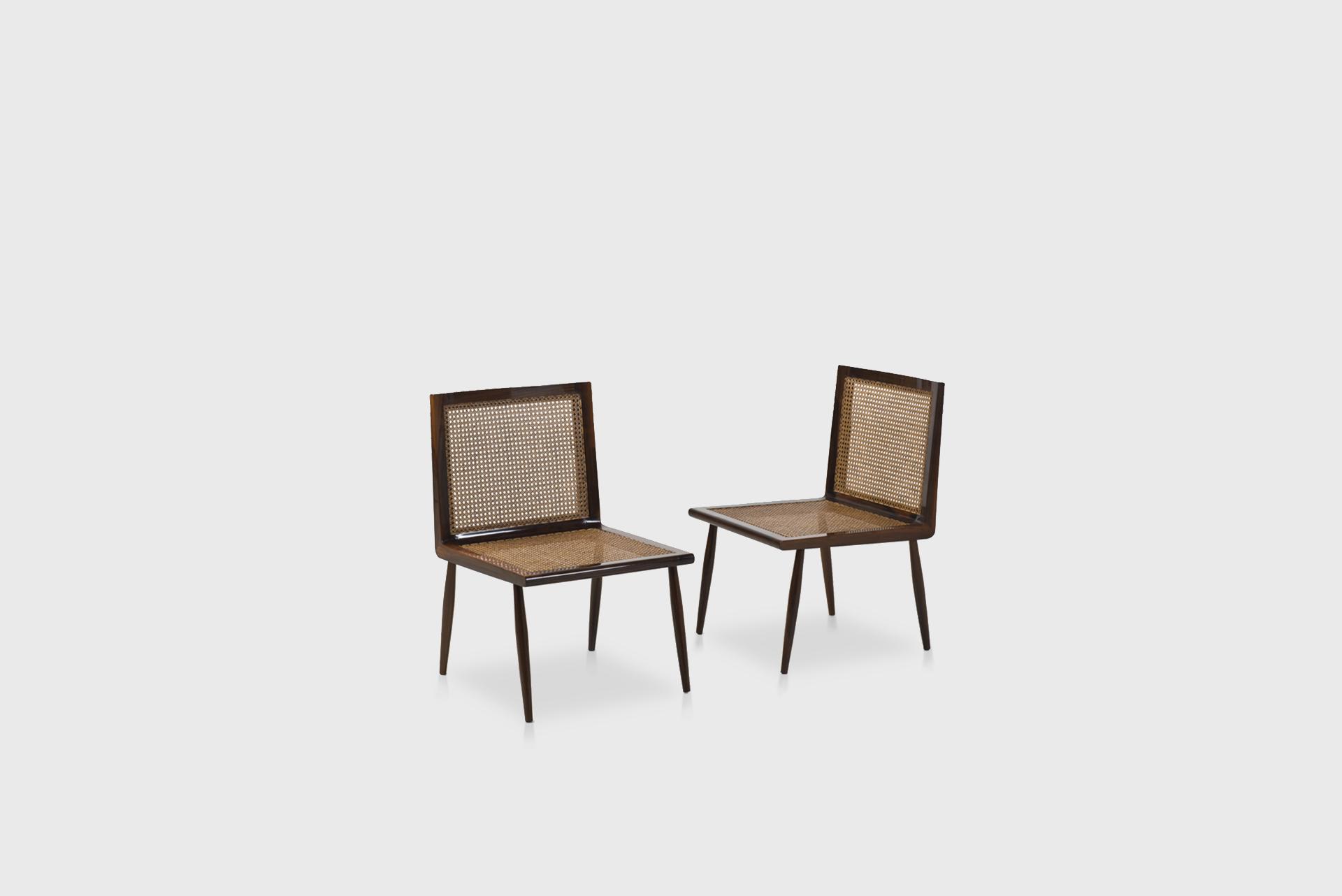 """Pair of lounge chairs model """"Cadeira baixa para quarto"""" Manufactured by Tenreiro Moveis e Decoraçaos Brasil, 1950 Solid jacaranda structure and cane"""
